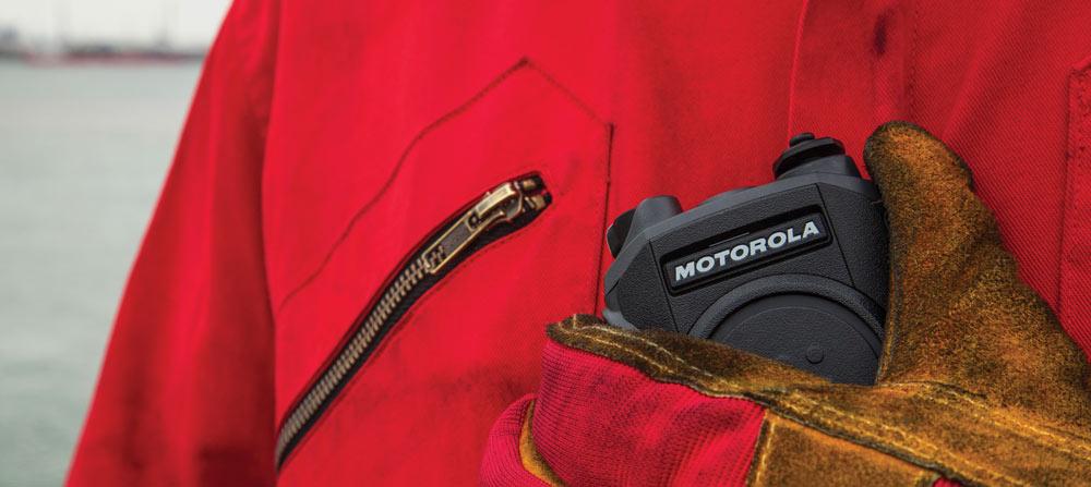 person holding Motorola two way radio